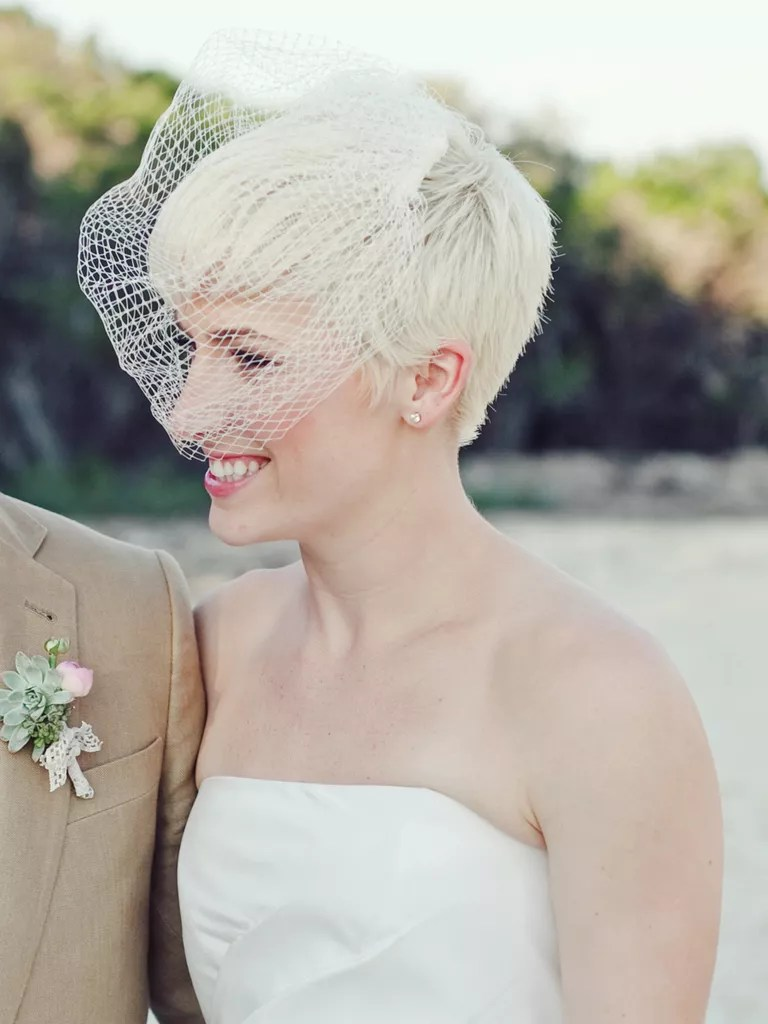 short wedding hairstyle with a veil