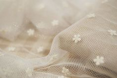 white tulle lace fabric, embroidered daisy lace fabric, vintage gauze lace fabric, polka dots lace fabric on Etsy, £8.08