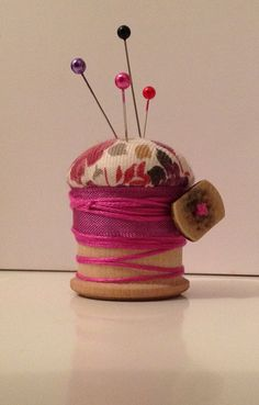 wooden spool pincushion