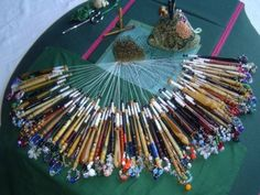 """In the BBC drama, Lark Rise to Candleford, Queenie (played beautifully by Linda Bassett) makes bobbin lace. Queenie says in the Season Four show, """"I was brought up to the pillow and taught to fling these here bobbins with the best of them. Every bead has it's own story."""""""