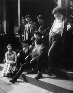 May we all hope to one day be half as cool as these stoop sitters. | 17 Vintage Pictures Of Dapper British Teddy Boys And Girls