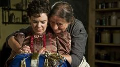 Queenie (played by Linda Bassett) and Ruby Pratt (played by Victoria Hamilton) in Season 4, Lark Rise to Candleford, BBC. In this touching scene, Queenie teaches Ruby how to make bobbin lace. So sweet!
