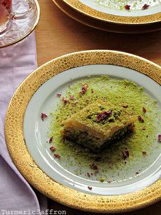 In Iran, a drier version of baklava is cooked and presented in smaller diamond-shaped cuts flavored with rose water. The cities of Yazd and Qazvin are famous for their baklava, which is widely distributed in Iran. Persian baklava uses a combination of chopped almonds and pistachios spiced with cardamom and a rose water-scented syrup and is lighter than Middle Eastern versions.