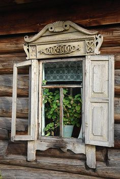 "Unexpected, shuttered window ""dresses up"" this cabin's humble exterior. #cabin #window"