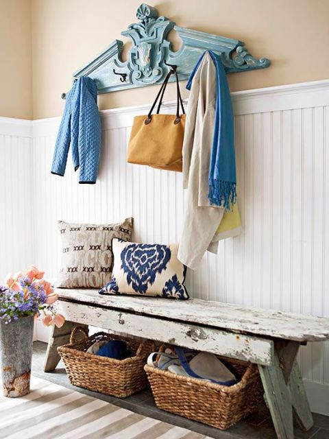 one of a kind pieces make a space unique - love the rustic bench & pediment turned coat rack in this functional & stylish entry
