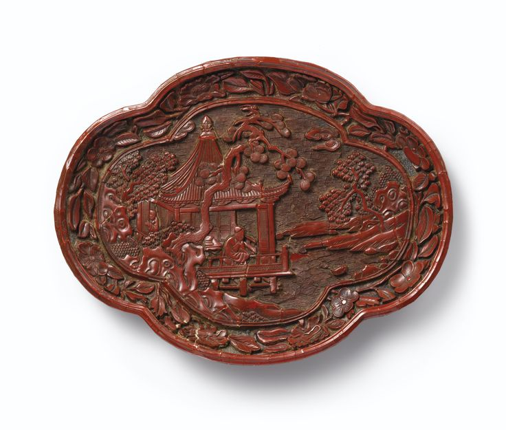 A rare carved cinnabar lacquer oval lobed dish, Yuan dynasty