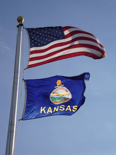 U.S. and Kansas flags flying together in Ashland, Kansas. Photo by courthouselover, flickr, via Pinterest