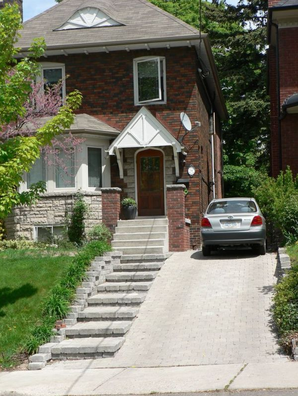 sloped driveway landscaping home