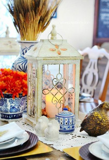 Forgo the typical rustic hues of Thanksgiving decor and adorn your table with shades of blue, white, and gold.