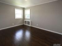 Grey walls+white molding+dark wood floor