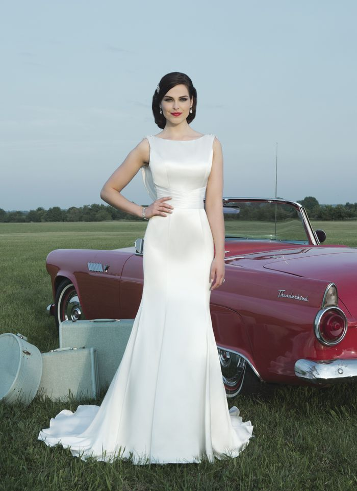 COMING SOON!!! Justin Alexander wedding dresses style 8727 Luxe charmeuse mermaid silhouette features a Sabrina neckline and a  pleated cummerbund.  Cowl back is adorned with beading at the shoulder.  Gown is finished with luxe charmeuse and beaded buttons over the back  zipper that trail down the chapel length train.