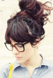 messy bun and bangs hairstyle