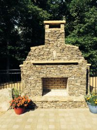 Outdoor stacked stone fireplace | Outside Ideas | Pinterest