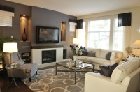 Modern living space with drak grey accent wall   We Know ...