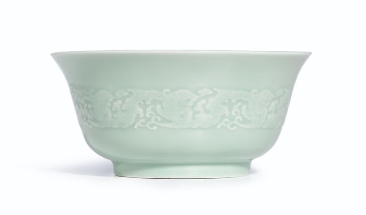 A moulded celadon-glazed 'Dragon' bowl,  Mark and period of Yongzheng