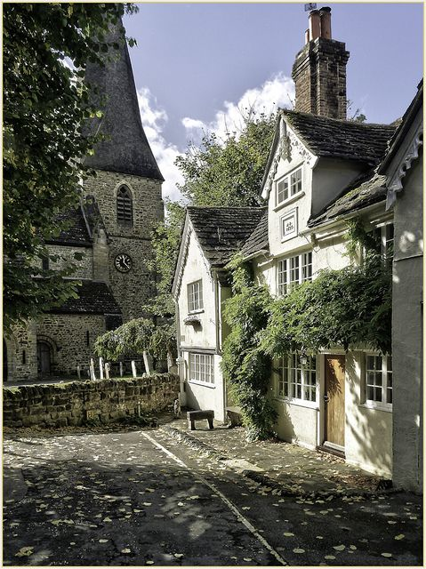 At the end of the Causeway In Horsham is this beautiful old cottage with St. Marys Church just beyond.  photo by Alan Fife