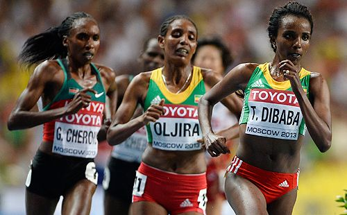 Tirunesh Dibaba Continues Her 10,000-Meter Dominance wins in 30:43.35, remaining unbeaten in 11 tries. In this picture Tirunesh Dibaba of Oromia  (Gold) leads Belaynesh Oljira of Oromia (Bronze) and Gladys Cherono