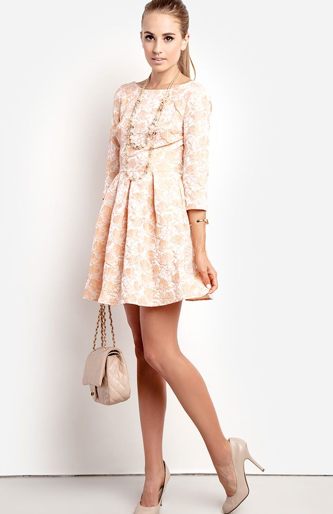 Wear this to meet the parents! The cut of the dress is conservative, but the flare skirt keeps it flirty and girly. Simple accessories will elevate the ladylike feel of the look.