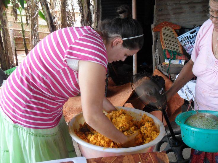 Ogles mixing the seasoning into the masá
