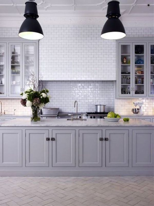 What a beautiful kitchen. Grey really is the in-colour at the moment, and those cabinets and the tiled back-splash create a beautiful finished look.