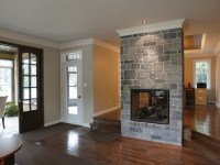 stone fireplace between two rooms. | rooms and decor i