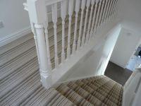 Strip carpet on stairs
