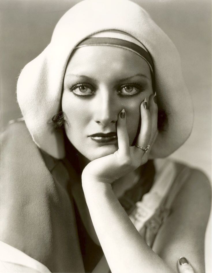 Joan Crawford models a 1920s hat