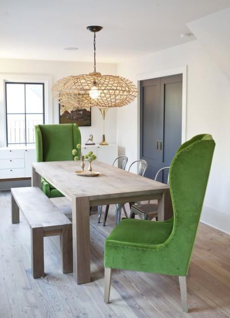 Rustic dining room with emerald green chairs