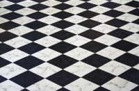 A Black and White Checked Floor