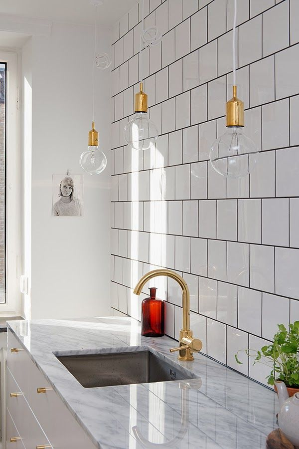 RIAZZOLI.: kitchen love - white offset square tile + black grout + hanging bulb light + marble counter + brass hardware