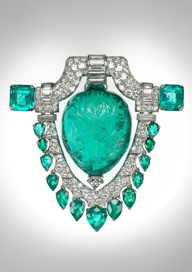 Marjorie Merriweather Post's lavish platinum brooch from the 1920s, featuring a 60-ct. carved Mughal emerald surrounded by diamonds.