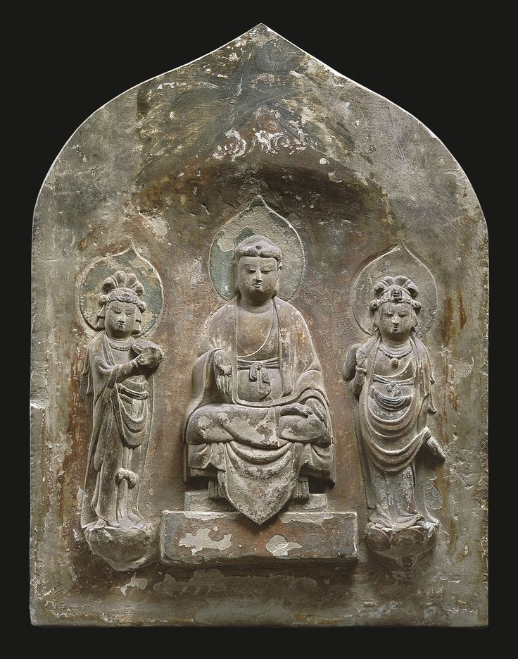 A polychromed limestone 'Buddhist Triad' stele, China, Tang dynasty, 8th-9th century