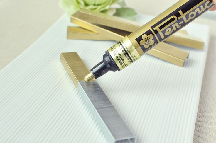 A paint pen can change your staples for those special items like invitations and programs {good idea!}