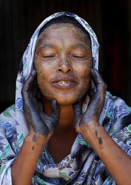 Beautiful Woman With Henna Painted Hands and qasil on her face, Hargeisa Somaliland by Eric Lafforgue, via Flickr