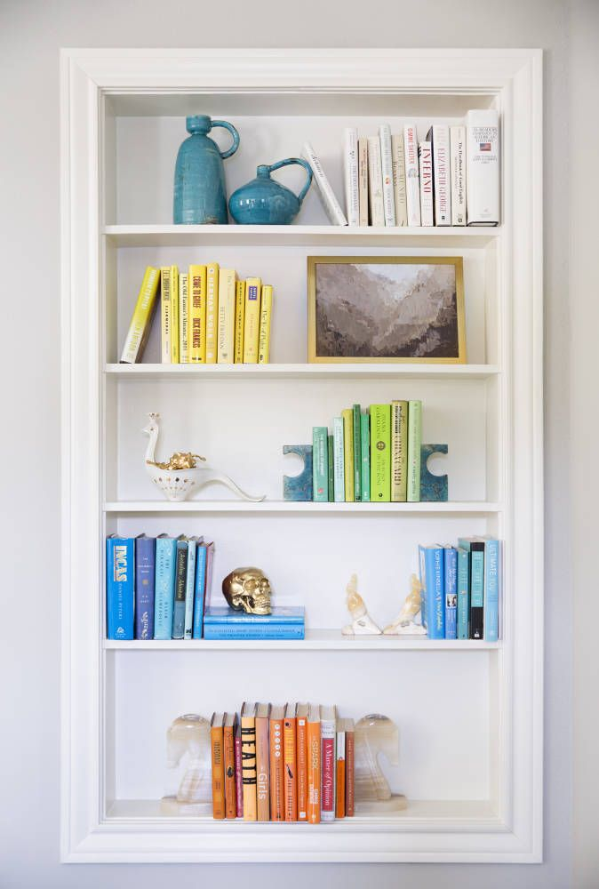 When painted white, a built-in bookshelf becomes a natural backdrop for one of Sally Wheat's vignettes | domino.com