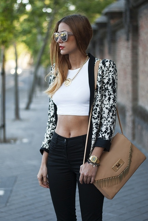Make a statement with a bold and oversized pair of sunglasses. A shape like this one where it hugs the face with almost zero curvature flatters any face shape. Here, the outfit is black X white with gold and neutral tones to accessorize. Shop similar sunglass styles now by clicking on the photo.  #stylist #styling #fashion #trends #chic #howtowear #stylistapproved #theLook