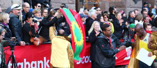 Oromian Runners Shatter Marathon Race Records.Oromo fans showed support to Oromian athlete Deressa Chimsa as he completed the fastest marathon run in Canada (Photo: Lagatafo Studio) http://gadaa.com/oduu/22602/2013/10/21/oromian-runners-shatter-marathon-race-records-in-canada-and-china/