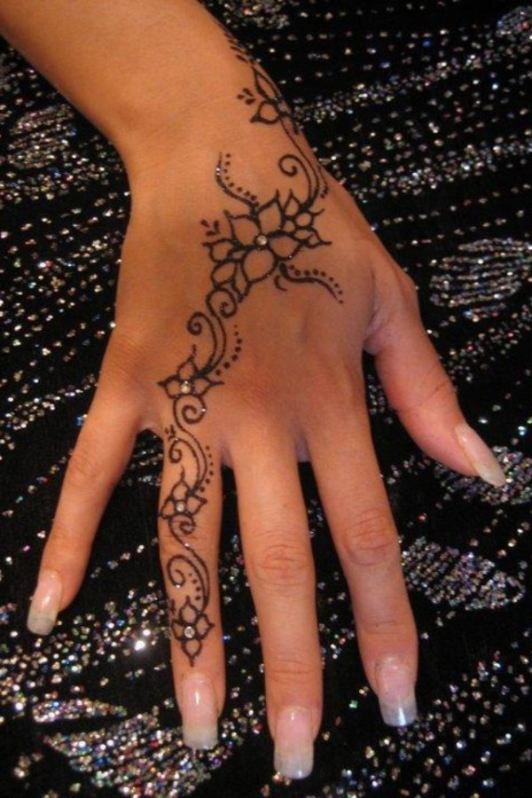 beautiful hand tattoo with jewels