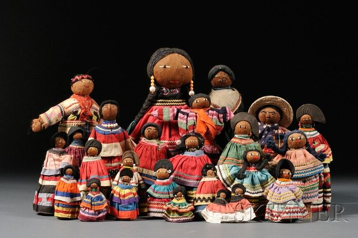 A museum display of tourist dolls dressed in Seminole strip dresses