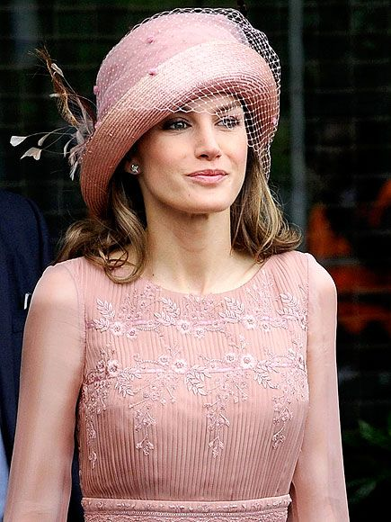 Chic in her hat.