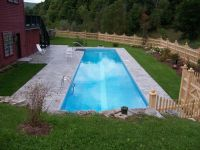 Cool rectangular rural backyard pool