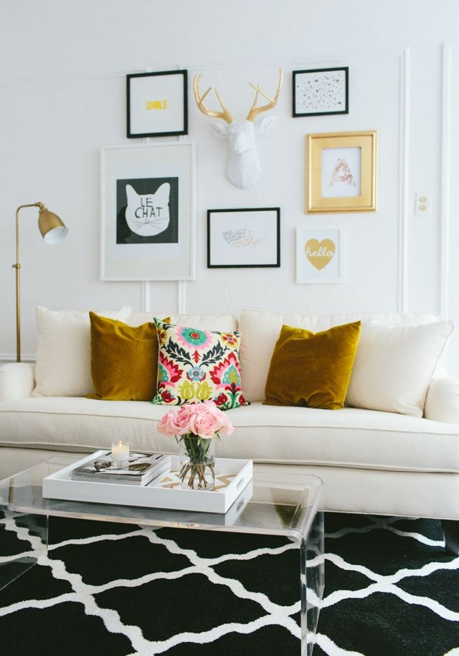 Fizz56 Dream Room Makeover: Winner's Home Tour #theeverygirl // #studio apartment // #gallerywall // graphic rug // white couch // black gold white