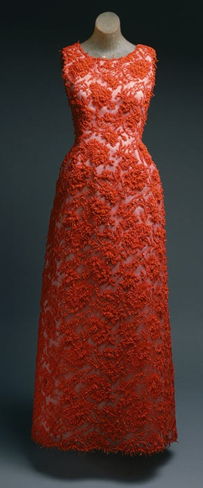 Evening gown of coral cotton lace re-embroidered with coral-colored beads and coral pieces by Hubert de Givenchy from 1963