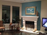 Teal accent wall with white mantel