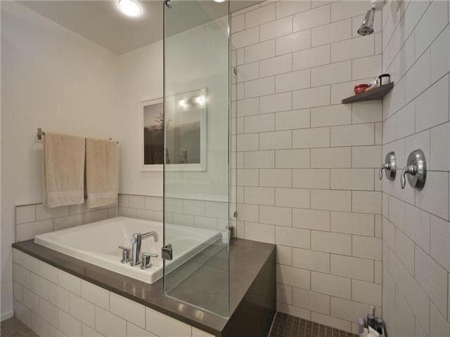 small soaking tub/shower combo