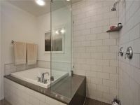 small soaking tub/shower combo