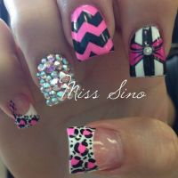 Pink girly nail design.