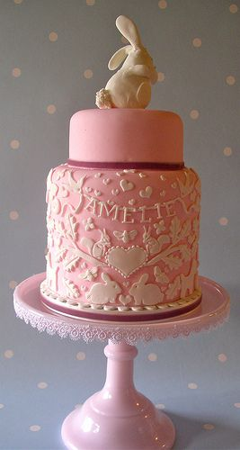 pretty cake without bunny, mini fresh flowers cake topper instead. Icing embroidery look, layered bottom tier of cake.