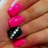 Hot pink nails w/ black jeweled one