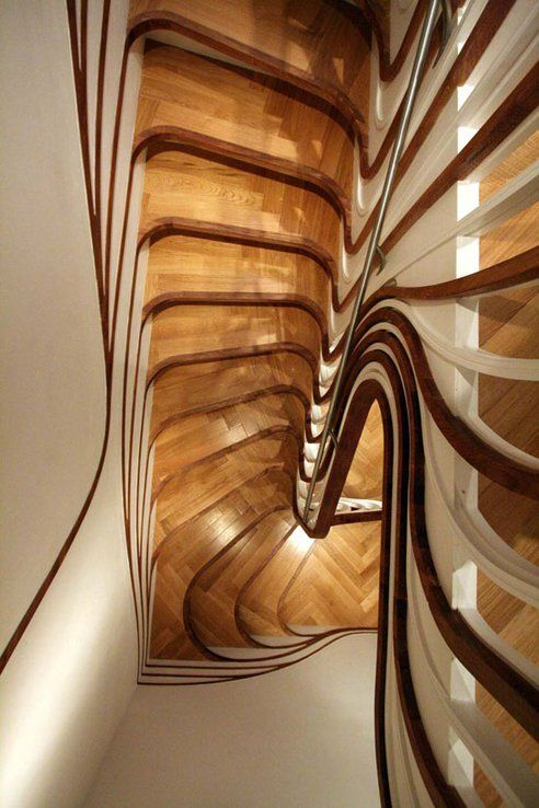 Stairs may serve a utilitarian purpose, but this breath-taking set of treads by UK-based Atmos Studio takes it to new heights. as part of a residential project, the stairDesigned s seem to come alive as it turns the corner, unravelling sculptural elements that organically encase and animate the transitional space